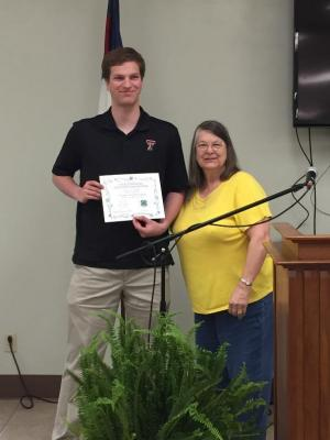 Christian Coffman is awarded a 4-H Scholarship Certificate from Extension Education District 8 Director, Laurie Veatch following BEEA's 2019 Luncheon with Style.