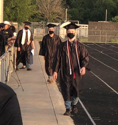 Graduates making their way to their seats.