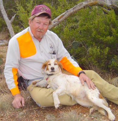 Dale Rollins with Lil' Annie, one of his many beloved bird dogs. (Photo courtesy D. Rollins)