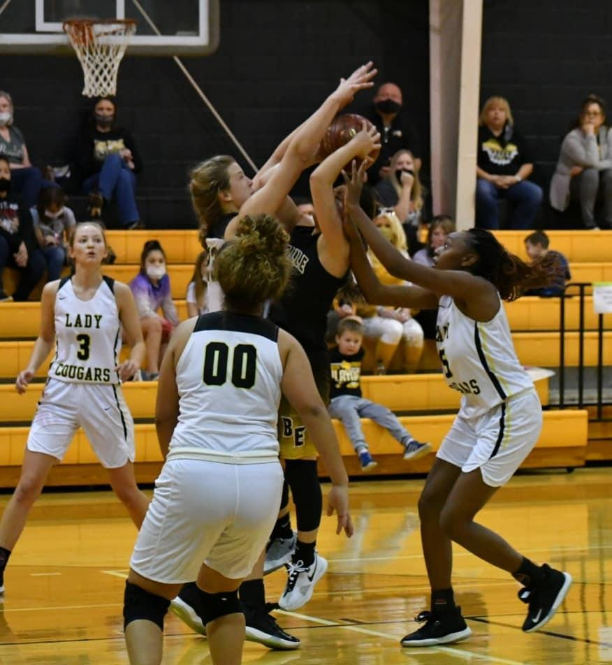 Lady Cougar Defense on alert to keep the ball away from the net.