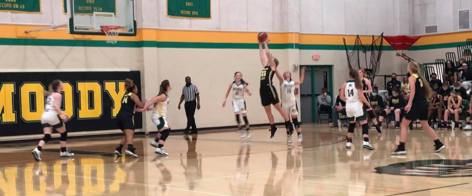 RL's Emma Hering, #23, making a leaping jump to score against the Moody Bearcats.