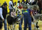 Jentry Moeller enjoys a Donkey Ride during half time at the Rosebud-Lott I.S.D. annual Donkey Basketball Game